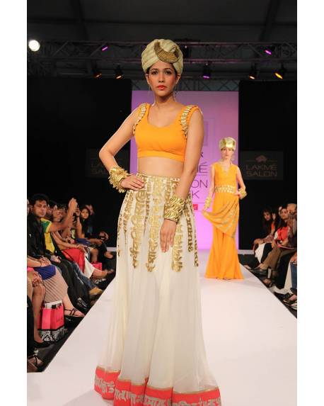 aa43e79f6ab722 Cream akshar georgette skirt with bright orange blouse & golden duppatta